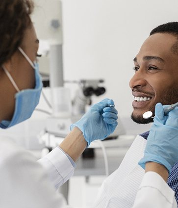 smiling person getting emergency dental care