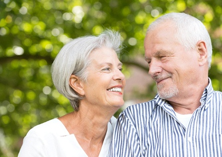 An older couple with MetLife dental insurance smiling at each other