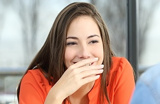 Woman covering her smile