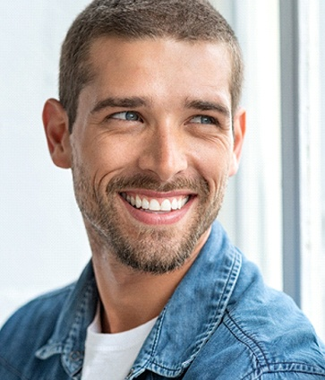 Man smiling with white, healthy teeth