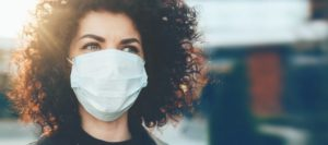 woman correctly wearing a face mask during the COVID-19 pandemic
