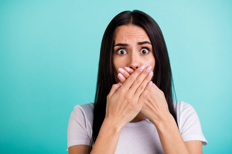 Woman covering her mouth in shock